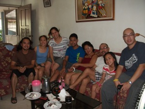 My father and my Mother with my  Sister and Brother back home